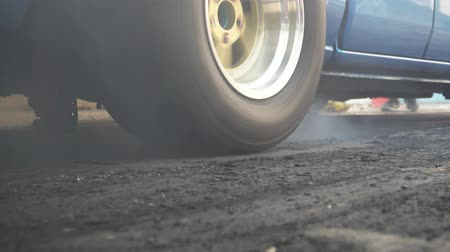 aro : Drag racing car burns rubber off its tires in preparation for the race Stock Footage