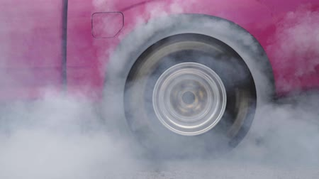 aro : Drag racing car burn tire at start line