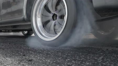 aro : Slow motion, Drag racing car burn tire at start line Stock Footage