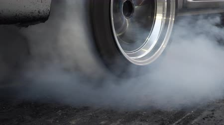 miglio : Drag racing car burn tire at start line