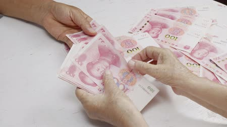 renminbi : Chinese Senior woman counting money for payment