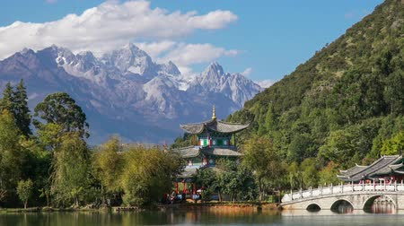 giada : Jade Dragon Snow Mountain and the Suocui Bridge over the Black Dragon Pool in the Jade Spring Park, Lijiang, Yunnan province, China.