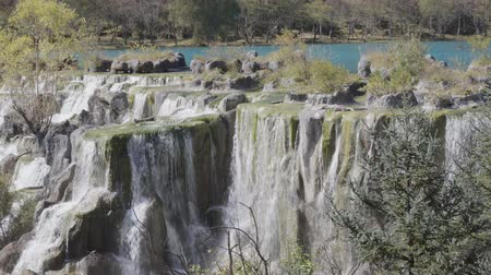 calcário : White Waterfall on Baishui River And Jade Dragon Snow Mountain ,Lijiang ,Yunnan ,China.
