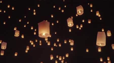 night : Tourist floating sky lanterns in Loy Krathong festival , Chiang Mai ,Thailand.