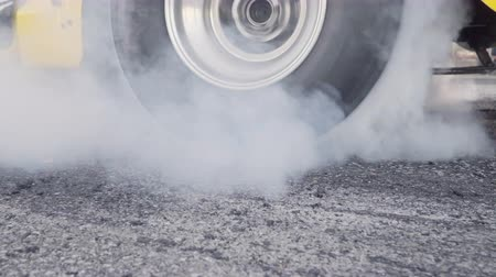 autobanden : Drag racing car burns rubber off its tires in preparation for the race Stockvideo