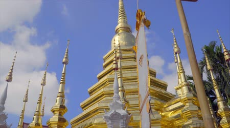 Pagoda and traditional zodiac religion flag in Wat Phan-Tao in old town Chiang Mai, Thailand Stock Footage