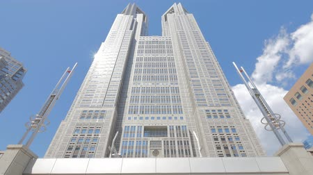 tokyo government : Tokyo Metropolitan Government Building and moving clouds against the blue sky Stock Footage