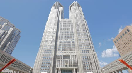 Tokyo Metropolitan Government Building and moving clouds against the blue sky Стоковые видеозаписи
