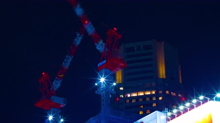 high rises : Cranes by night time lapse at Shibuya middle shot low angle Stock Footage