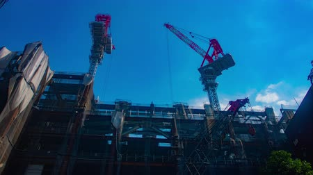 em desenvolvimento : Cranes at under construction in Shibuya wide shot time lapse
