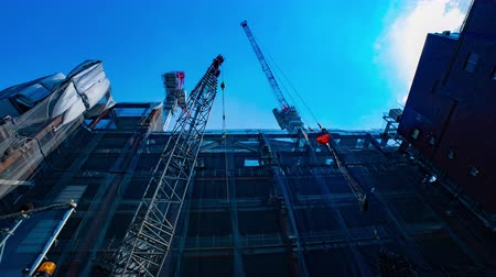 строительные леса : Cranes at under construction in Shibuya wide shot time lapse