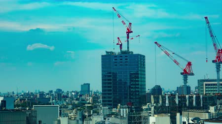 high rises : Cranes on the building in Shibuya time lapse Stock Footage