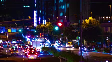 exposition : Night busy street at Aoyama avenue time lapse middle shot Vidéos Libres De Droits