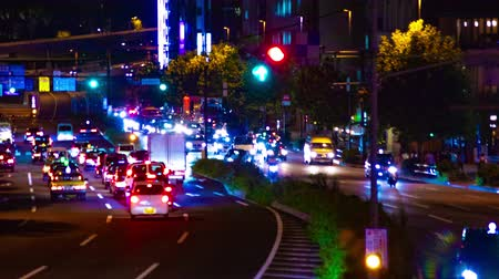 poz : Night busy street at Aoyama avenue time lapse middle shot Stok Video