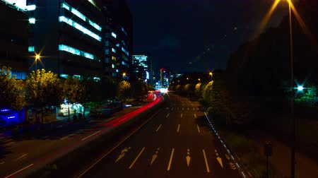 verkeersbord : Night time lapse at Aoyama avenue wide shot slow shutter