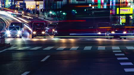 auto in movimento : Rush street all'incrocio in Shinjuku time lapse