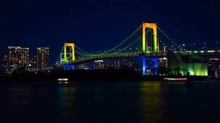 západ : Night timelapse at the rainbow bridge in Odaiba Tokyo