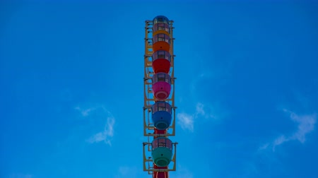 карусель : Ferris wheel behind the blue sky in Odaiba Tokyo time lapse middle shot Стоковые видеозаписи