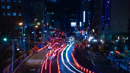 tilt : Night time lapse urban street at the business town in Tokyo