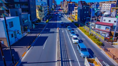 tilt : A timelapse of the city street at the downtown in Tokyo daytime wide shot tilt