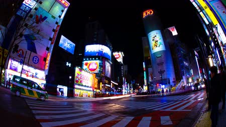 busy line : Night time lapse crossing at the neon town in Shibuya Tokyo wide shot