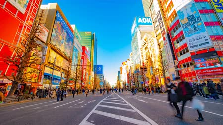 манга : A timelapse of the downtown street at the electric town in Akihabara Tokyo daytime wide shot