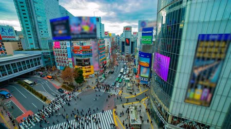 crosswalk : A timelapse of the famous crossing in Shibuya Tokyo high angle wide shot daytime Stock Footage