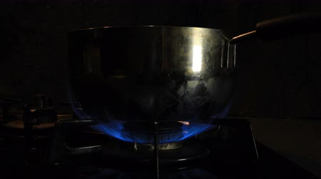 gas burner flame : Ignition of the heat under the silver pot in the kitchen