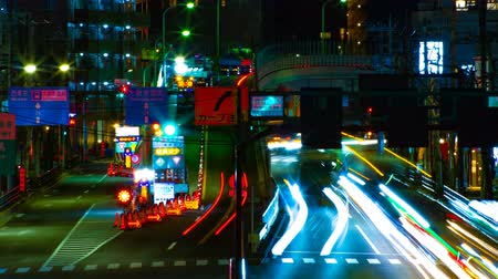 neon lights : A timelapse of the street at the downtown in Tokyo at night long exposure middle shot