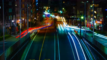 poz : A timelapse of the street at the downtown in Tokyo at night long exposure middle shot