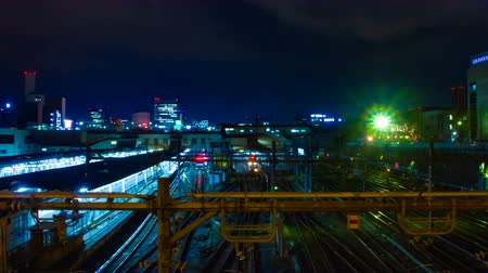 neon lights : A timelapse of the train at Ueno station at night wide shot