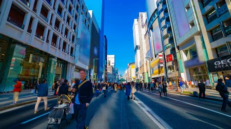 crossing road : A timelapse of the city street at the downtown in Ginza Tokyo daytime wide shot