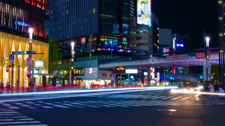 chuo city : A timelapse of the street at the downtown in Ginza Tokyo at night long exposure wide shot Stock Footage