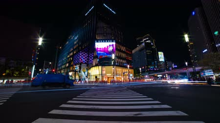 ginza : A timelapse of the street at the downtown in Ginza Tokyo at night long exposure wide shot Stock Footage