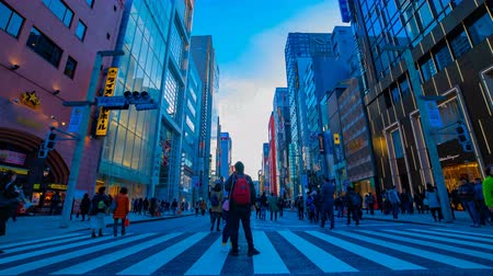 winkel straat : A timelapse of the city street at the downtown in Ginza Tokyo daytime wide shot