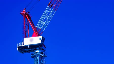 rakomány : A time lapse of moving cranes behind the blue sky at the under construction in Tokyo