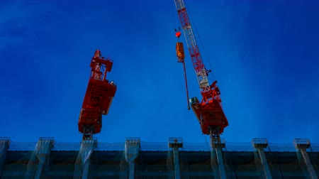 construction crane : A time lapse of moving cranes at the under construction in Tokyo