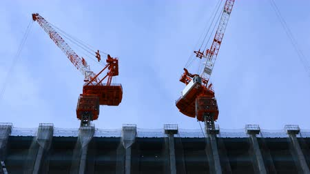 em desenvolvimento : Cranes at the under construction in Tokyo wide shot Vídeos