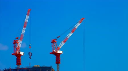 rakomány : A timelapse of cranes at the under construction behind the blue sky in Tokyo