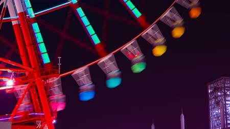 carnival ride : A timelapse of ferris wheel at the amusement park in Tokyo at night