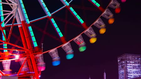 lapso de tempo : A timelapse of ferris wheel at the amusement park in Tokyo at night
