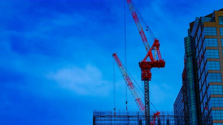 em desenvolvimento : A timelapse of cranes at the under construction on the building in Tokyo