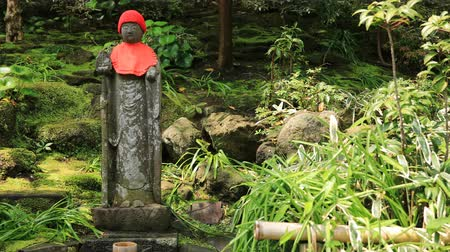 cappello rosso : Japanese statue at the traditional guarden at Hokokuji in Kamakura handheld