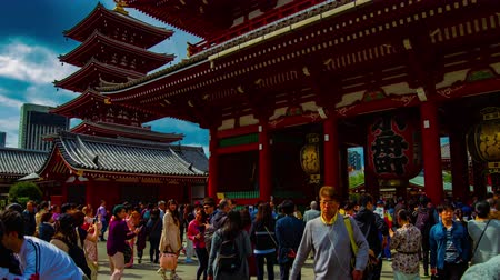 A timelapse of main old fashioned gate at Sensouji temple in Asakusa Tokyo wide shot
