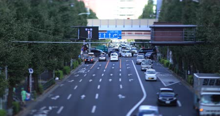 tilt : Moving cars at Oume avenue in Tokyo daytime tiltshift