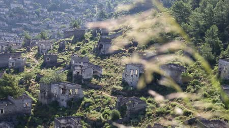 ruinous : Empty house ruins in Kayakoy village at south of Fethiye in southwestern of Turkey Stock Footage