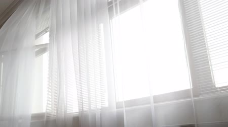 White transparent moving curtains.