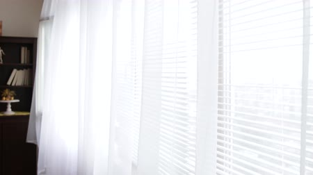 шить : White moving curtains at jalousie window. Стоковые видеозаписи