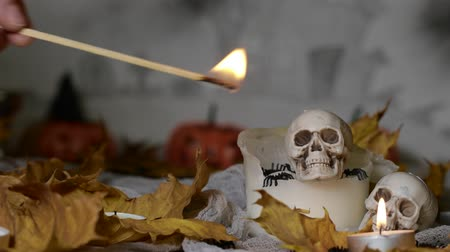 Witch is turning on the candles. Scaring Halloween atmosphere. Closeup Vídeos