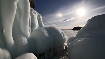 descoberta : Big icicles on the rock on frozen lake baikal.